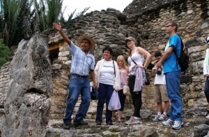Quintana Roo University archaeology professor Guillerno Ramirez gives the UBC Spanish Summer Field School an insight into ancient Mayan culture at the ruins in Kohunlich. On April 14, this sun aligns this fork-shaped stone to another stone on the opposite end of the plaza.