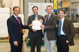Joe Nemeth, president and CEO of Canfor Pulp Products Inc., presents a $75,000 grant award to  André Phillion, Mark Martinez, and James Olson, director of the Pulp and Paper Centre at UBC.