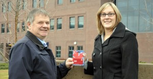 Garry Appleton, director of Security and Parking Services, presents a $100 fuel card to Jessica Beck, booking and scheduling clerk for Enrolment Services at UBC's Okanagan campus. Beck won the through a Carpool Week prize draw.