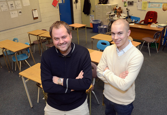 UBC alumni and Okanagan Mission Secondary School senior math teachers Paul Janke, left, and Graham Johnson have implemented a flipped classroom where the students watch their lesson online at home and they discuss what they learned in class the next day.