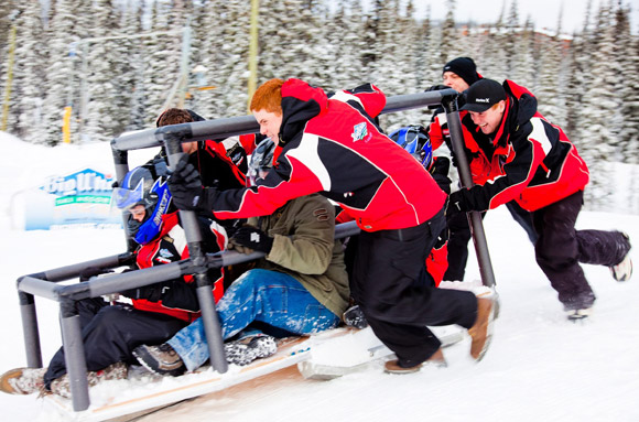 Students from the UBC's Okanagan campus School of Engineering give their concrete toboggan a push while testing it out at Big White.