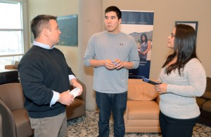 Aboriginal student Cody Kenny, in third-year Human Kinetics, middle, chats with Arthur Stevens, Bridging Program co-ordinator, Dalhousie University, left, and Kara Paul, Manager of the Aboriginal Health Sciences Initiative at Dalhousie University during their visit to the Okanagan campus.