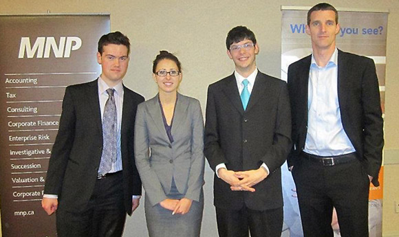 Okanagan campus Faculty of Management students, from left, Eric Binotto, Ciera Elliott, Maxime Walker and accounting instructor Sandy Hilton teamed up to win first place at the Gathering of Accounting Associates, Professionals and Students competition.