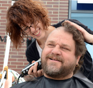At last year's Cut for the Cure event at UBC's Okanagan campus, UBC employee Chris Kraft sported a new look after Katie Cavanagh from Marvel College shaved his head.