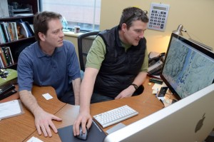Human geography student Shayne Wright, left, and Jon Corbett, assistant professor of Community, Culture and Global Studies, check out some of the comments at a food mapping website they developed.