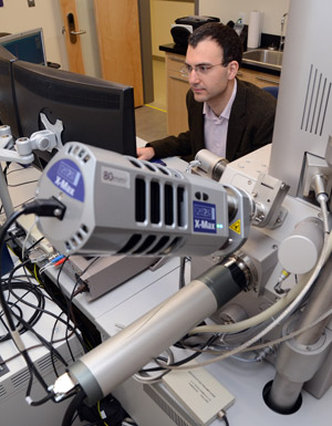 In one of many examples of research underway at the University of British Columbia's Okanagan campus, Andre Phillion, assistant professor of mechanical engineering in the School of Engineering, uses a  scanning electron microscope to conduct an experiment.