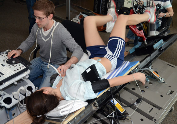 Researcher Mike Stembridge from Cardiff University, Wales, measures respiratory responses in the Health and Exercise Sciences lab in Kelowna, as UBC student Lauren Ray exercises on a specially built collapsible bike that will accompany the research expedition to Mount Everest.