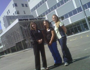 Kelowna General Hospital Administrator Tracy MacDonald and UBC nursing student Samantha Waller and Jennifer Jabs, outside the new Centennial Building. The students and their classmates will be helping out with moving patients into the new facility this Sunday.