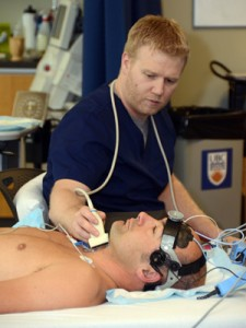 PhD student Kurt Smith conducts a procedure measuring blood flow to the brain on Gordon Binsted