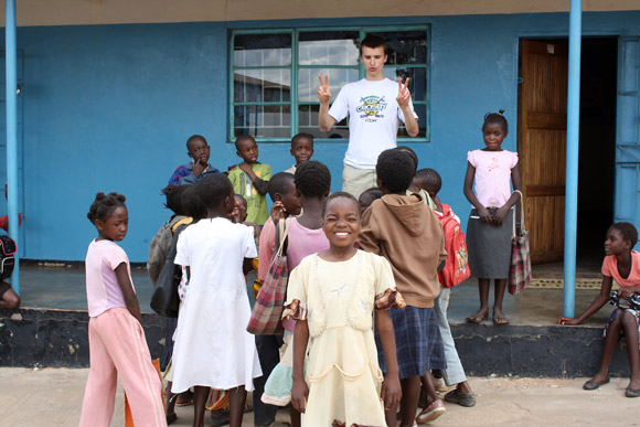Tim Krupa plays with children orphaned by HIV and tuberculosis in the impoverished Chazanga compound in Lusaka, Zambia.