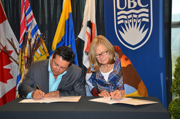 Westbank First Nation Chief Robert Louie  and Deborah Buszard, Deputy Vice-Chancellor and Principal of UBC's Okanagan campus, sign a memorandum of understanding between the Okanagan Nation Alliance and UBC on Friday morning.