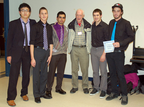 (L-R) UBC engineering students Colin Yang, Carter Merwin, Navdeep Brar, with Ken Campbell of the Myra Canyon Trestle Restoration Society and engineering students Ryan Baines and Luc Cowan.