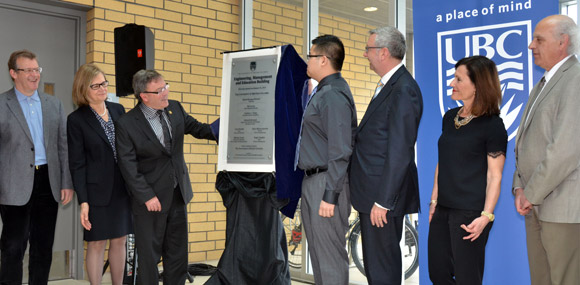 Unveiling the new dedication plaque at UBC's Engineering, Management and Education building official opening ceremony were, from left: Roger Sugden, dean, Faculty of Management; Deborah Buszard, principal and deputy vice chancellor, Okanagan campus; Ben Stewart, BC minister of Citizens' Services and Open Government, Curtis Tse, student, Faculty of Management; Stephen Toope, president, UBC; Lynn Bosetti, dean, Faculty of Education; and Spiro Yannacopoulos, associate dean and director, School of Engineering.