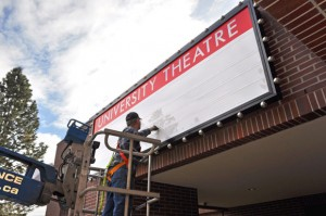 Installation of the new University Theatre sign at UBC's Okanagan campus.