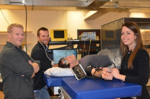 Kurt Smith, Anthony Bain, and Jinelle Gelinas conduct tests on student volunteer Kevin Wildfong. All four graduate students conduct research through the UBC Okanagan campus Centre of Heart, Lung, and Vascular Health.