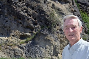 Murray Roed stands beside a sandstone and conglomerate outcropping estimated to be about 50 million years old. Geologists have determined that White Lake flowed through the Okanagan valley at this time, winding between towering volcanoes, leaving behind rocky deposits like this one on Boucherie Road in West Kelowna.