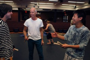 Creative Studies department head Neil Cadger (centre), introduced the Interdisciplinary Performance program three years ago. Students in the program take performance art, creative writing, and visual arts courses to give them a well-rounded performance-based education.