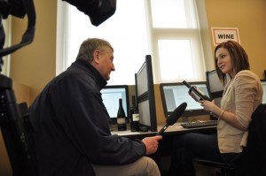 CHBC Global TV reporter Barry McDivitt interviews student Chae Ratzlaff about wine marketing during a Celebrate Research Week open house at the Faculty of Management.