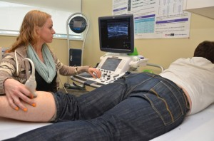 Carey Simpson conducts an ultrasound procedure on the calf of volunteer John Bocti. As a fourth-year Human Kinetics student at UBC's Okanagan School of Health and Exercise Sciences last year, Simpson conducted research that discovered significant differences in male versus female physiology when it comes to pre-exercise routines.