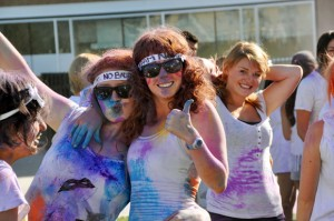 "Participants such as Jess O'Toole and Kate Helmore (foreground, left to right) are turned into human canvases during Colour Me UBC. Part of Create on Sept. 3, the event outfits students with Tuum Est (""It is up to you)"" T-shirts and a colour mixture made from cornstarch and tempera paint powder."