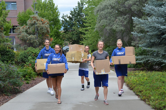Members of UBC's Heat women's basketball team, Julia Reichert, Emily Kanester, Olivia Johnson, Laura Marcolin, and Shenelle Tamminen are ready to help move boxes during student move-in day Sunday.