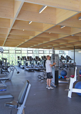 The ceiling of the cardio and weight room, about 5,000 square feet of workout space, sports the cross-laminated timber beams that give the facility a light and airy feeling.