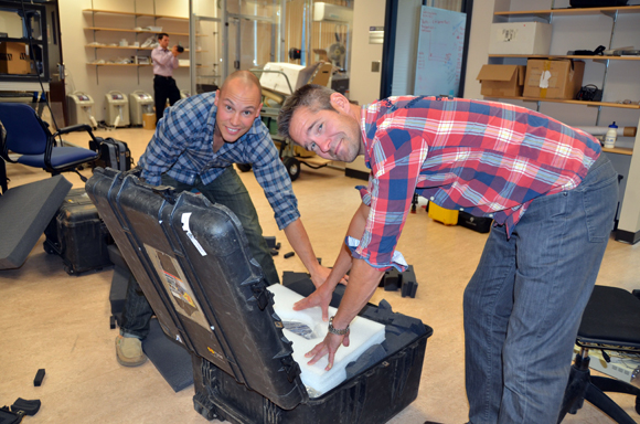 PhD student Chris Willie, left, and UBC Prof. Phil Ainslie pack up state-of-the-art ultrasound equipment, which will be used to monitor blood gases flowing to the brains of free-dive athletes during breath-hold experiments in Croatia.