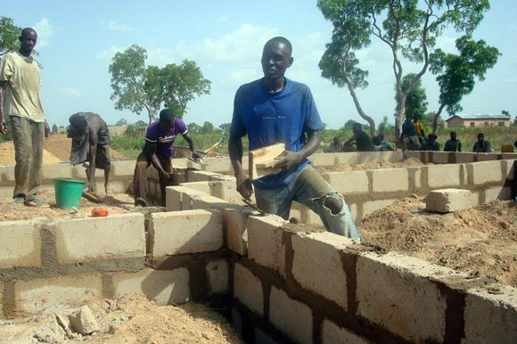 Local workers build footings for the nursing clinic in Chanshegu, Ghana.