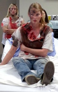 UBC nursing student Bobbi Bennett, as a 'casualty' in a recent mock disaster exercise in Vernon.