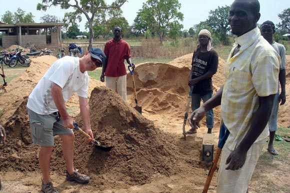 Wade Bottorff of Kelowna, (t-shirt and shorts) volunteered to help build the nursing clinic in Chanshegu, Ghana.