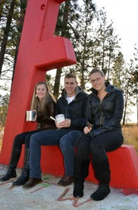 Engineering students Tia Haunts, Will Patterson, and Heather Mallory are ready to paint the iconic red E white, so participants in the memorial service next week can then write messages of hope and inspiration onto the E.
