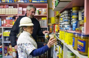 Bob Rymarchuk and Phyllis MacPherson, chairperson of the Lake Country Food Assistance Society, stack canned goods at the Lake Country Food Bank.