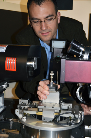 André Phillion peers inside the 3-D X-ray computed tomography microscope