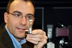 André Phillion demonstrates how small the samples are that will be imaged by the 3-D X-ray CT microscope. He can later view a picture magnified 1,000 times and in 3-D imagery on his computer monitor.