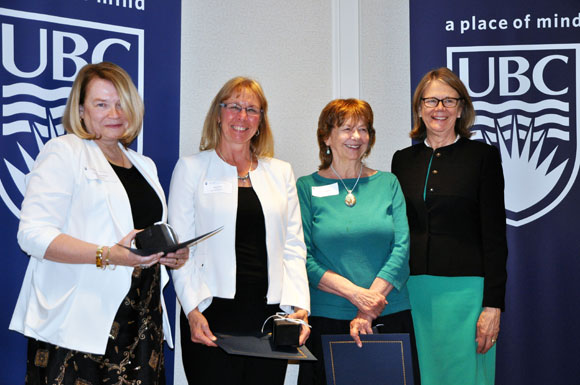Carolyn MacHardy, Joyce Boon, and Doris Callaghan, are congratulated by Deborah Buszard, Deputy Vice-Chancellor and Principal of UBC Okanagan, for 35 years of service.