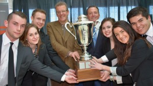 "Winning team members of UBC's Faculty of Management Live Case Competition, shown with the Argus Cup, are, from left: Branden Watt, Kaylin Westbrook, Russell Hoefsloot, Dean Roger Sugden, Argus Properties chief executive officer Ted Callahan, Kirsten Rancier, Keren Noy and Russel Jarvis. Callahan, CEO of Argus Properties, a privately owned Kelowna real estate investment company, which owns the Four Points Sheraton hotel, is donating $75,000 to the Faculty of Management over five years. The donation is in support of the faculty's annual Live Case Competition. At the end of the Live Case Competition, Callahan awarded the winning team the ""Argus Cup"" and a $5,000 scholarship award. Both runner-up teams were awarded scholarships of $1,500."