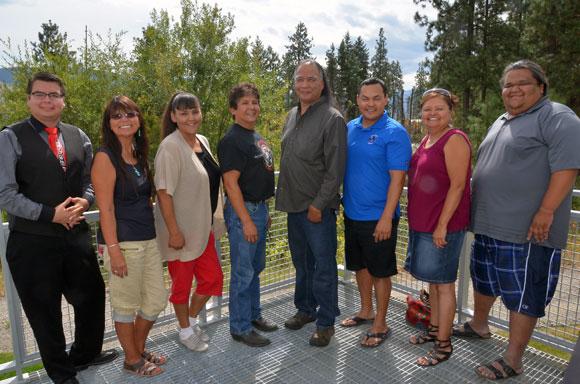 Marlowe Sam, fourth from right, was joined at his thesis defense by community supporters including, from left: Joseph Pierre, councillor, Penticton Indian band; Pauline Terbasket, executive director, Okanagan Nations Alliance; Yvonne Weinert, councillor, Osoyoos Indian Band; Clarence Louie, Chief, Osoyoos Indian Band; Sam; Jonathan Kruger, Chief, Penticton Indian Band; Inez Pierre, councillor, Penticton Indian Band; Travis Kruger, councillor, Penticton Indian Band.