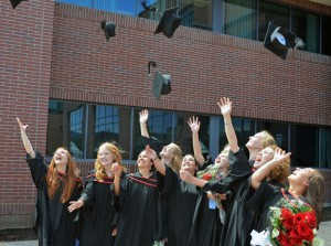 In time-honoured tradition, UBC School of Nursing graduates toss their mortarboards in the air at 2013 Convocation.