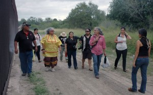 Margo Tamez, third from right, walks along the Texas-Mexico border wall near the community of El Calaboz, with Lipan Apache elders, law students of the University of Texas Law Human Rights Clinic, and documentarians. Photo by Clemente Guzman
