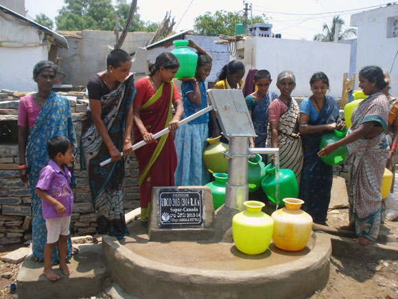 Women and children in the village of Jangala Kottalu are used to carrying water to their part of the village. Now, thanks to the dessert buffet organized by students in UBC's Residence Association they have fresh water from a new well.