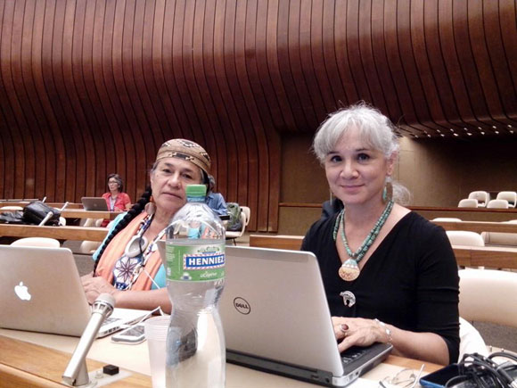Margo Tamez, right, sits with Chief Caleen Sisk (Winnemum Wintu Tribe) in the Palais des Nations