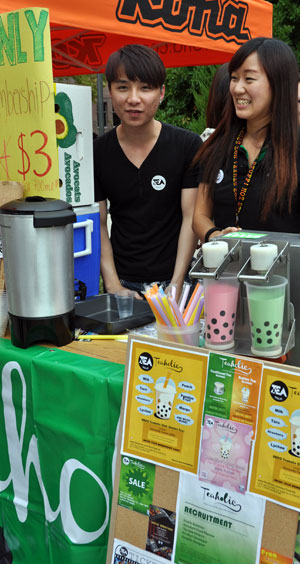 Grace Mak, right, serves bubble tea during a university event.