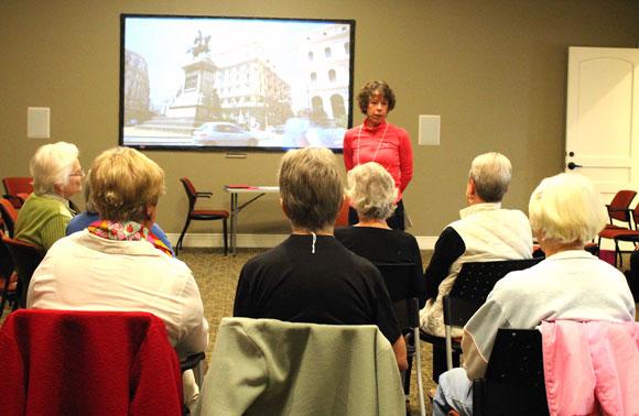 UBC Associate Professor Charlotte Jones talks with a group of Walk n' Talk participants at the Heritage Retirement Residence.