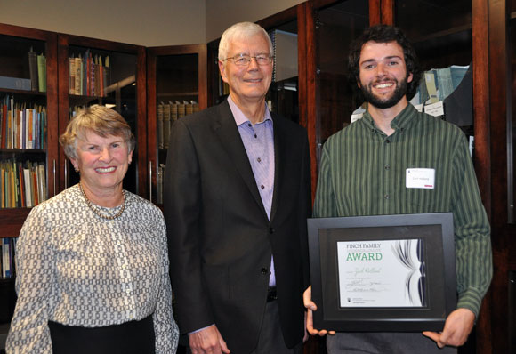 Zach Holland, right, receives the inaugural Finch Family Undergraduate Scholarship Award from Jean and Ken Finch.
