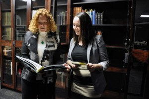 Okanagan campus Chief Librarian Heather Berringer (left) and librarian Arielle Lomness look over a few of the materials donated for UBC Okanagan's Special Collections Room.