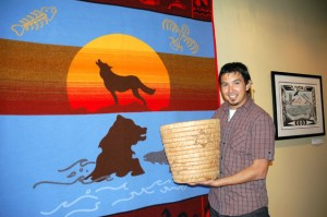 UBC graduate Jordan Coble, with Westbank First Nation art that he curates as curatorial and heritage researcher for the Sncəwips Heritage Museum.