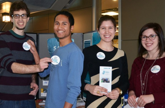 UBC Okanagan students Alan Freund, Andry Ramorasata, Lauren Gaudet, and Mallory Herzog are ready with stickers and brochures for Denim Day on campus Wednesday, January 21. Denim Day is part of Sexual Assault Awareness Month on campus