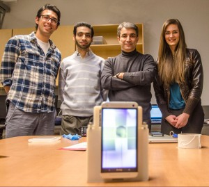 With the smartphone lab prototype, from left, Engineering Instructor Ali Ahmadi, PhD Candidate Mohamed Yafia Salem, Assoc. Prof. Homayoun Najjaran, and mechanical engineering student Jessica Van Brummelen