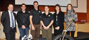 Interior Saving's Gene Creelman (left) poses with CRIS staff, Eric Rampone, Troy Becker, and Dawn Widdifield, along with UBC Okanagan's Rebecca Frechette and Sally Willis-Stewart in front of a newly-delivered Parks Explorer.