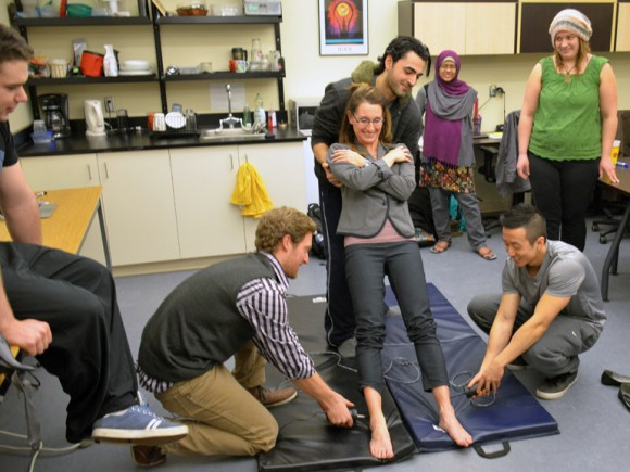 UBC Asst. Prof. Jennifer Jacoki and students in a physiology demonstration during Celebrate Research Week 2014.